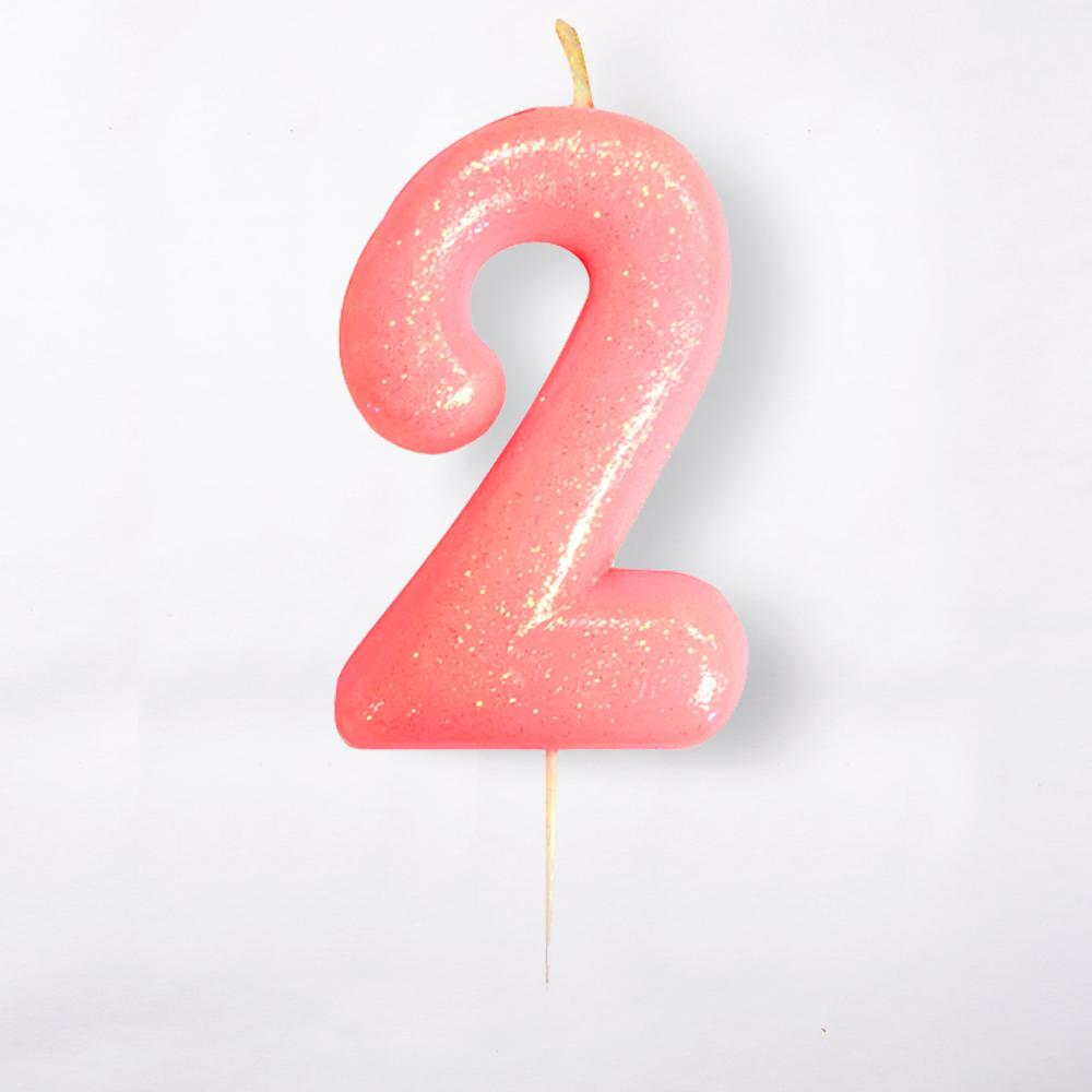 A number 2 light pink cake candle with a glittery surface