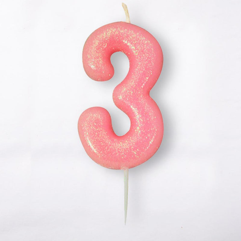 A number 3 light pink cake candle with a glittery surface