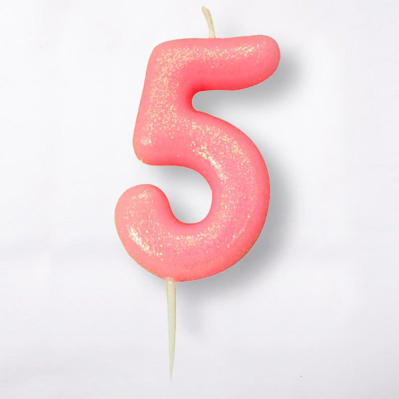 A number 5 light pink cake candle with a glittery surface
