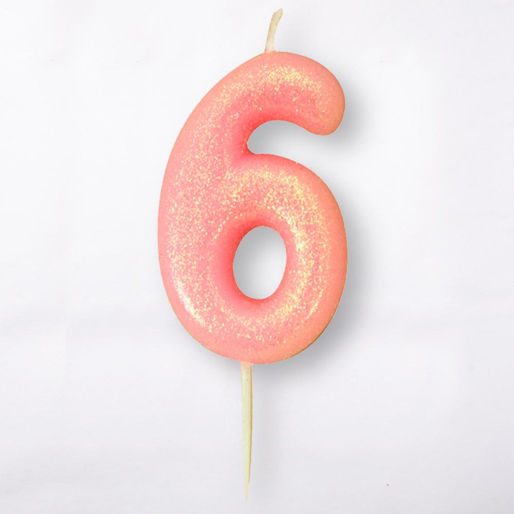 A number 6 light pink cake candle with a glittery surface