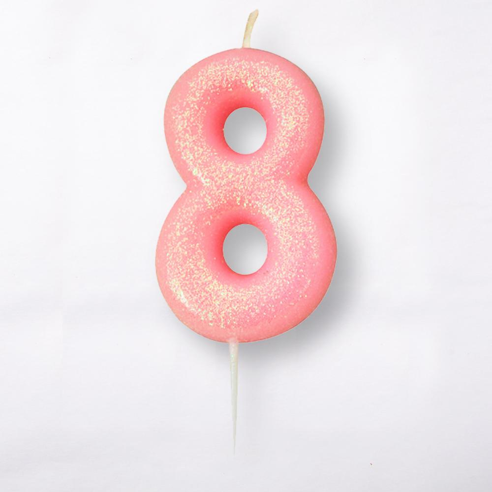 A number 8 light pink cake candle with a glittery surface
