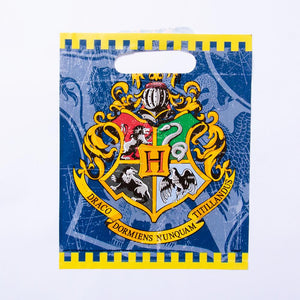 A Harry Potter-themed party gift bag with a Hogwarts crest design