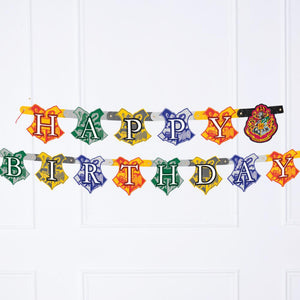 A Harry Potter-themed party banner with a Happy Birthday greeting