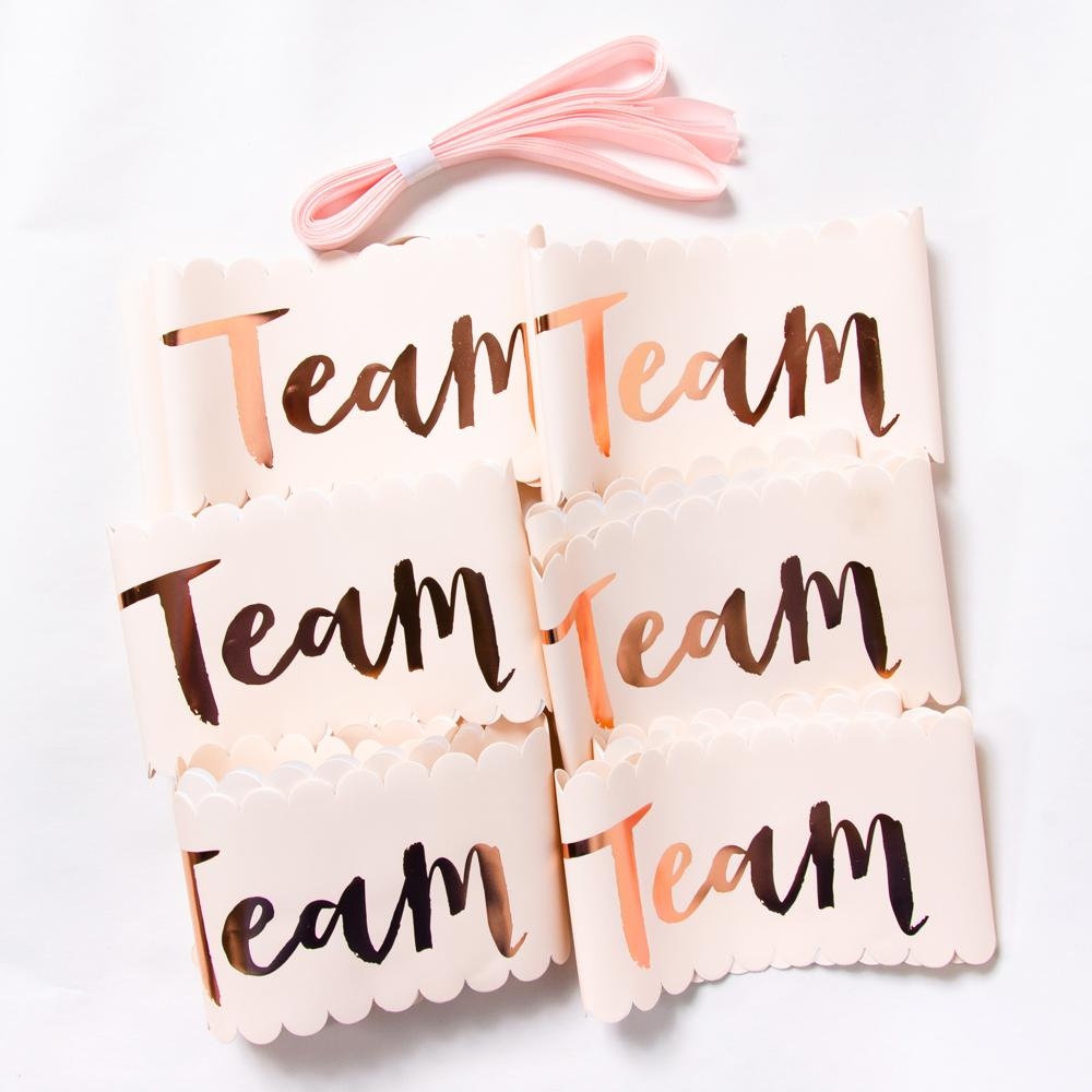 "6 pastel pink hen party sashes with the phrase ""Team Bride"" written on each"