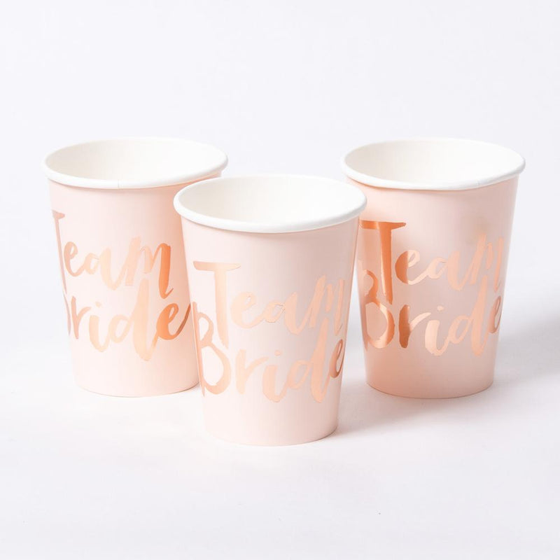 "3 Pastel pink cups with a ""Team Bride"" phrase written in rose gold foil text"