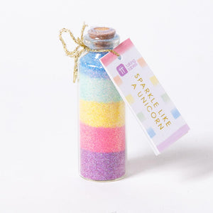 A bottle filled with layers of multicoloured sparkle dust