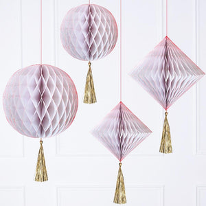 4 iridescent pink honeycomb pom poms in spherical and diamond-shapes