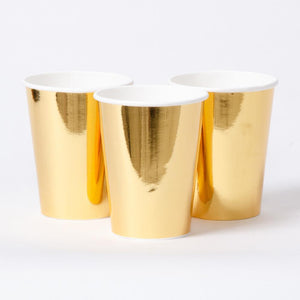 3 metallic gold paper party cups with white rims