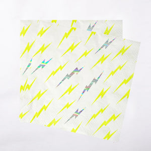 2 white party napkins with a yellow and iridescent foil lightning bolt pattern