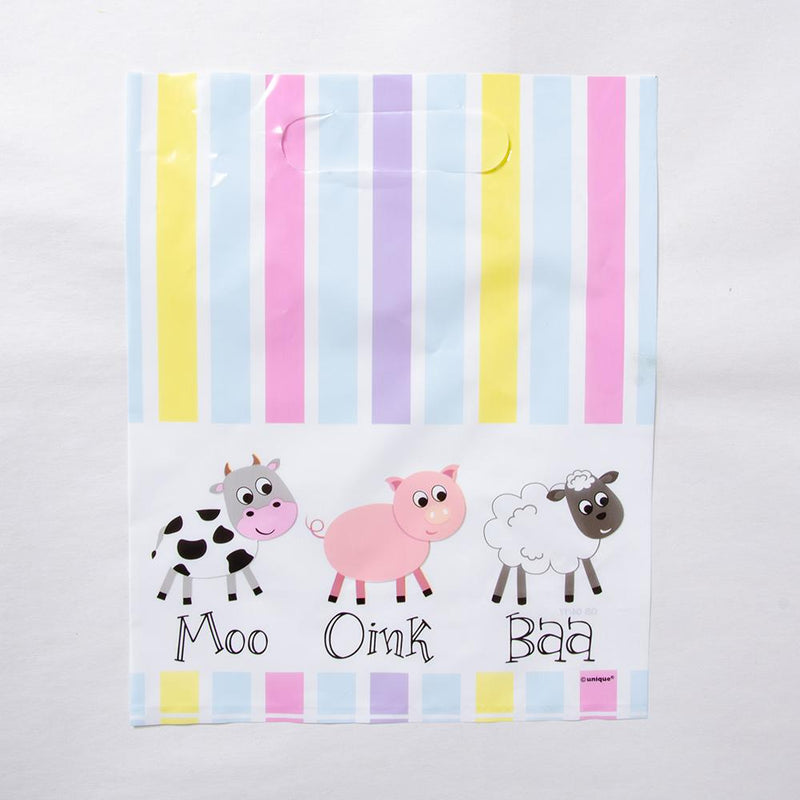 A farm yard-themed party bag with stripey pastel colours and a cow, sheep, and pig