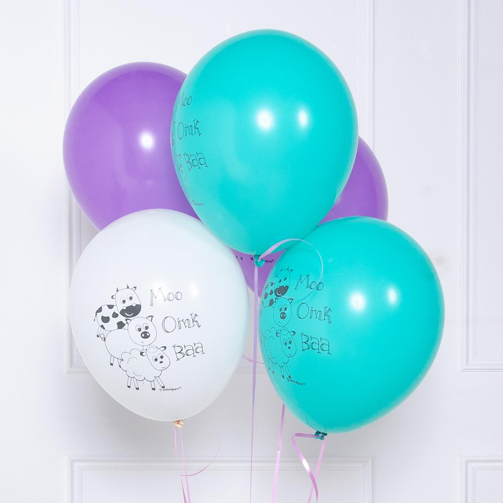 A bunch of farm yard-themed party balloons in white, blue, and purple colours