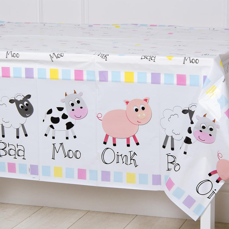 A party table cover with a farm yard-themed design