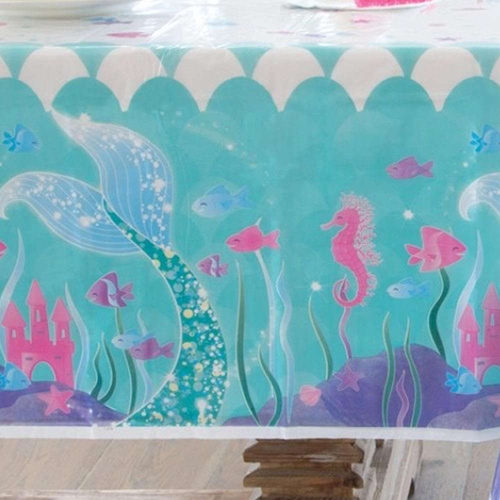 A mermaid-themed party table cover with pink seahorses and a glittery mermaid tail design