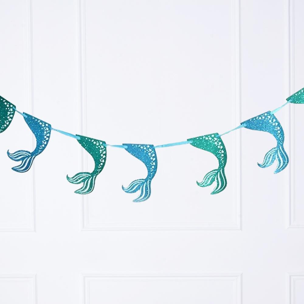 A mermaid-themed party bunting with mermaid tail pennants