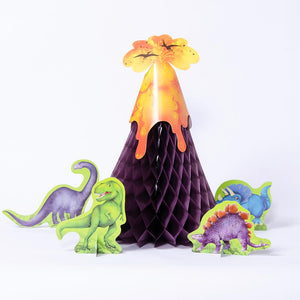 A paper honeycomb volcano party centrepiece with dinosaur characters