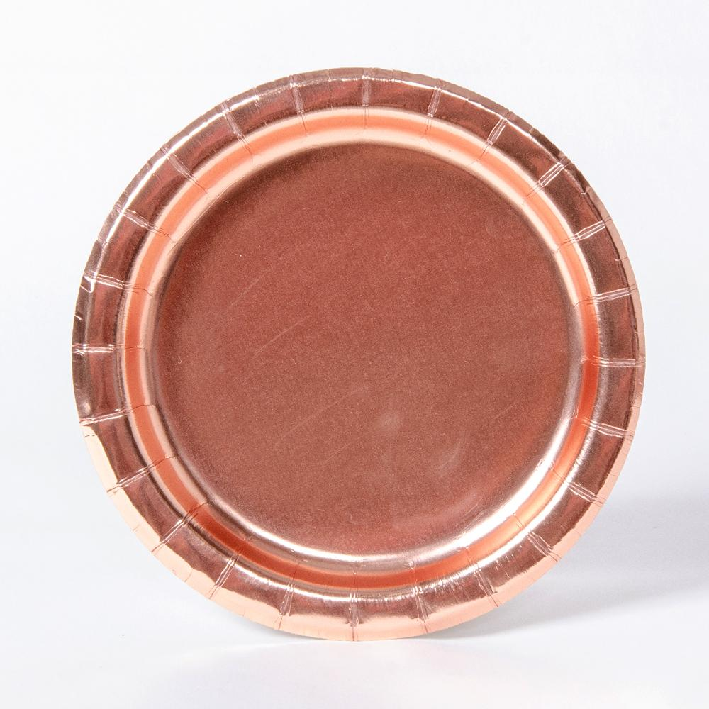 A round, rose gold foiled party plate