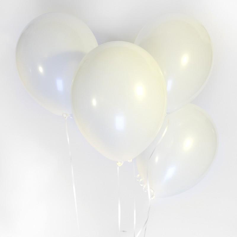A bunch of clear white latex party balloons