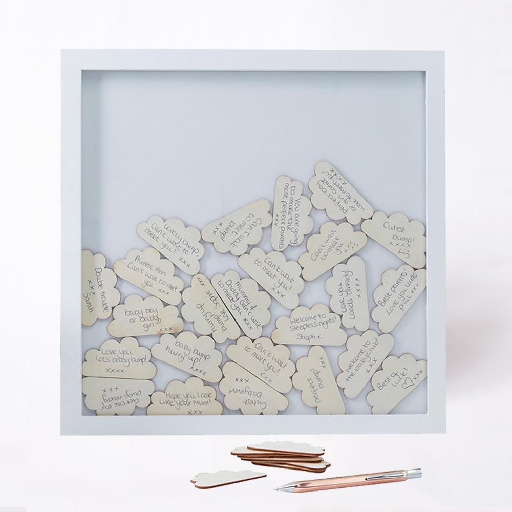 A box frame filled with messages written on wooden cloud shapes
