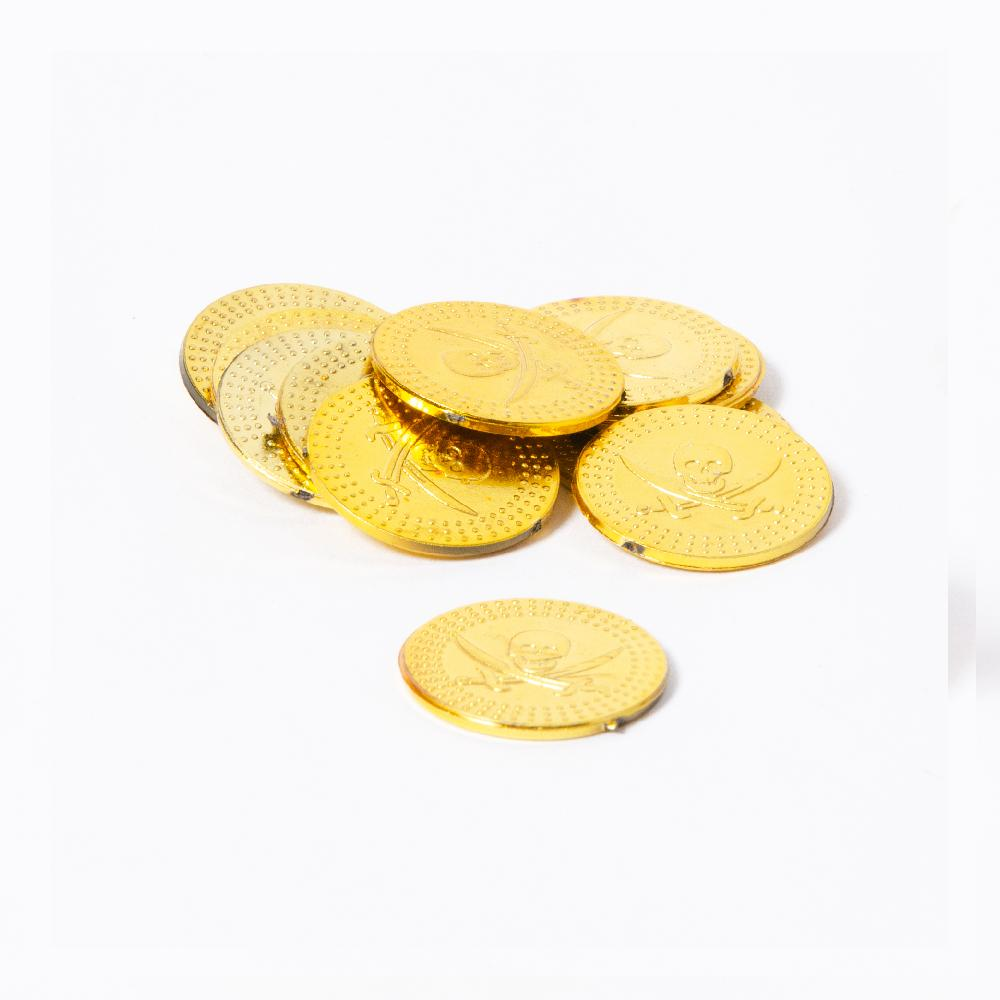 A pile of gold plastic pirate coins featuring a skull and crossbones design