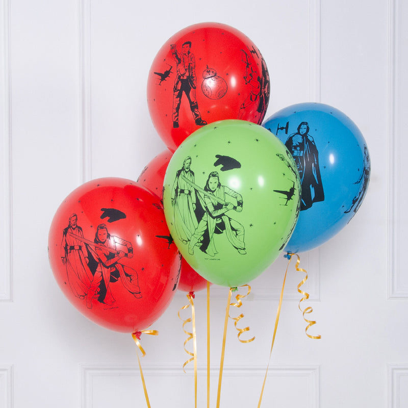 A bunch of red, green, and blue latex party balloons featuring star wars designs