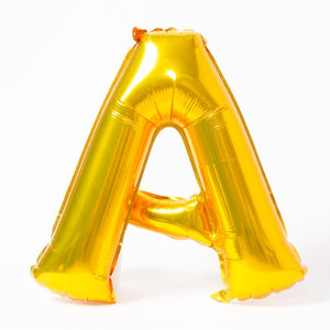 "A shiny metallic gold letter ""A"" balloon"
