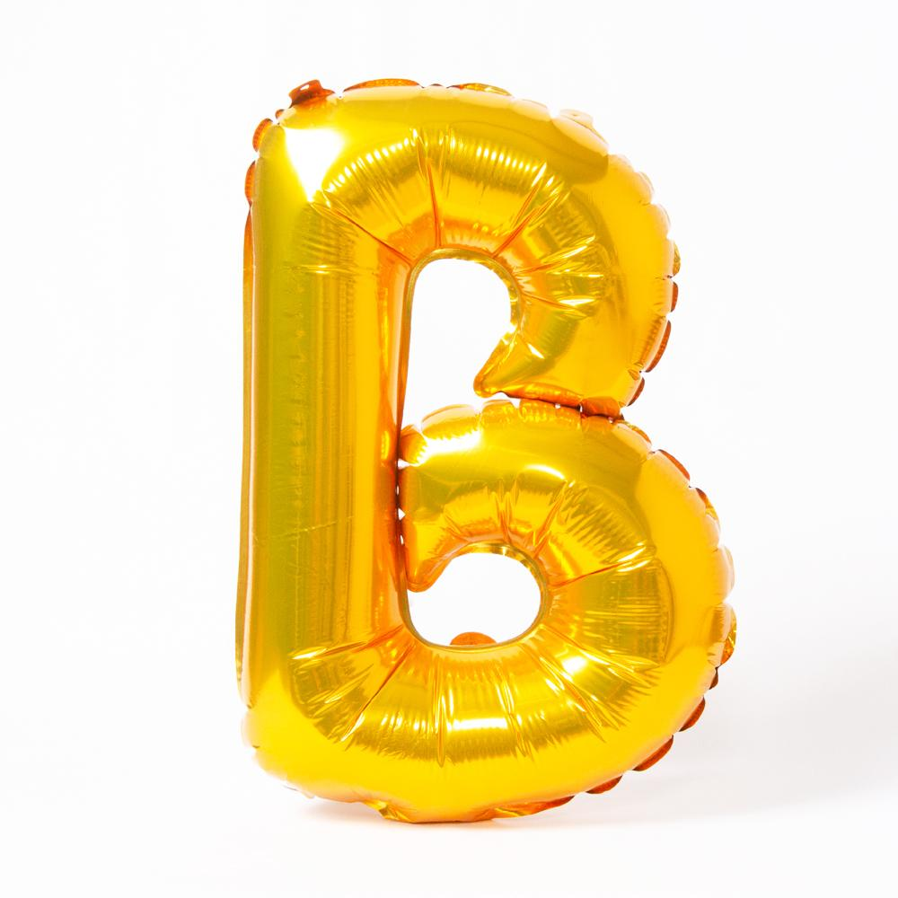 "A shiny metallic gold letter ""B"" balloon"