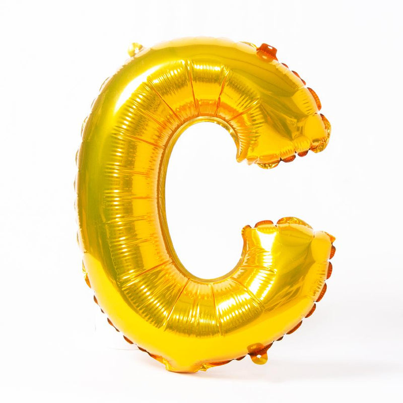 "A shiny metallic gold letter ""C"" balloon"