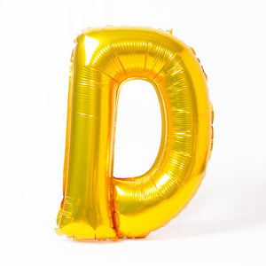 "A shiny metallic gold letter ""D"" balloon"