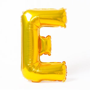 "A shiny metallic gold letter ""E"" balloon"