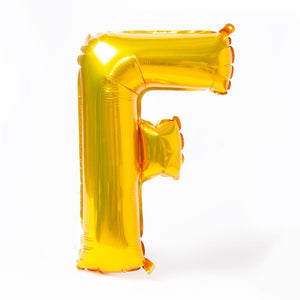 "A shiny metallic gold letter ""F"" balloon"