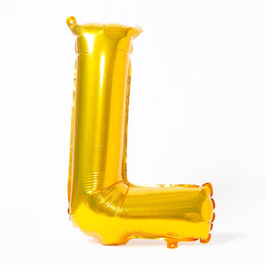 "A shiny metallic gold letter ""L"" balloon"