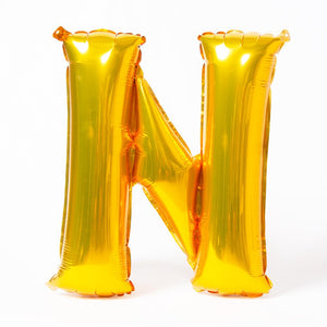 "A shiny metallic gold letter ""N"" balloon"