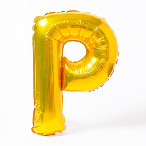 "A shiny metallic gold letter ""P"" balloon"