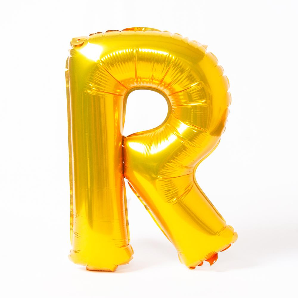 "A shiny metallic gold letter ""R"" balloon"