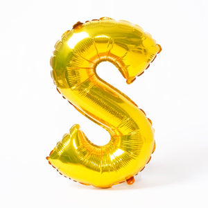 "A shiny metallic gold letter ""S"" balloon"