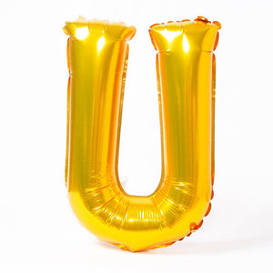 "A shiny metallic gold letter ""U"" balloon"