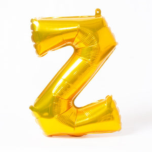 "A shiny metallic gold letter ""Z"" balloon"
