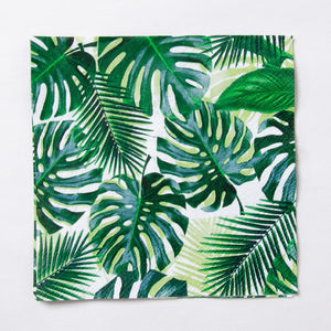 A jungle-themed party napkin with a tropical palm leaf design