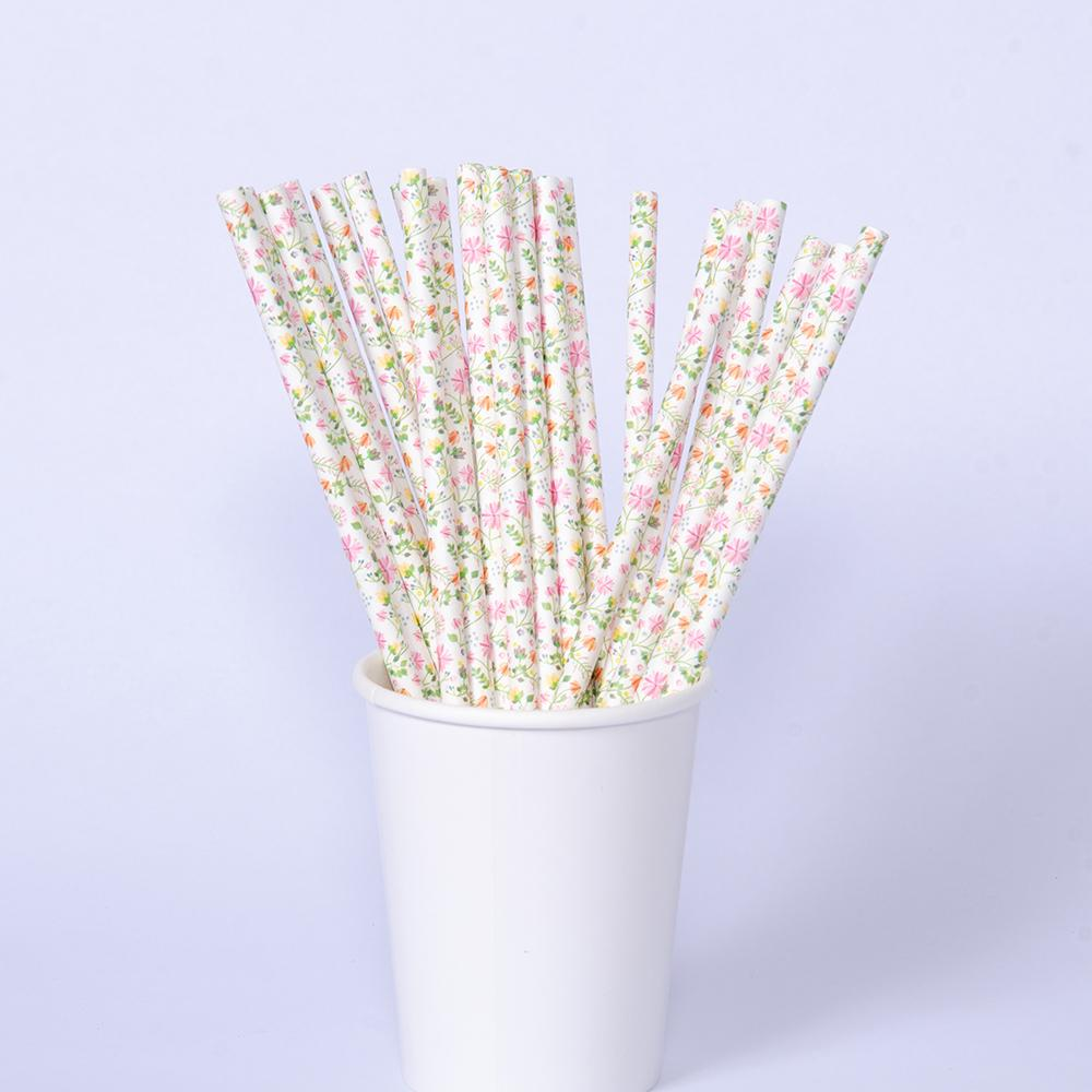 A cup filled with floral-patterned paper party straws