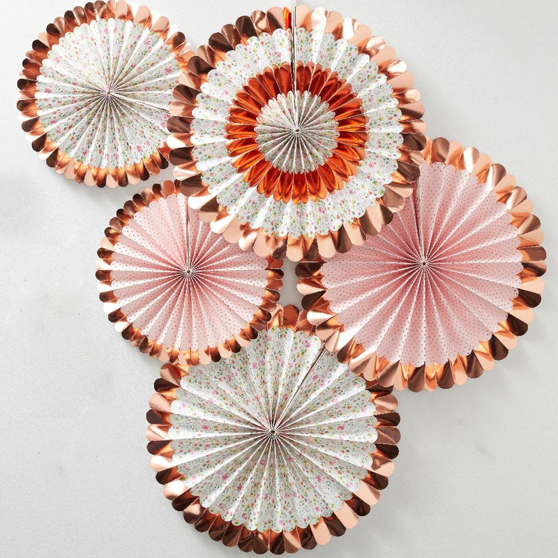 A set of pink and white pastel party fans with a rose gold foil trim