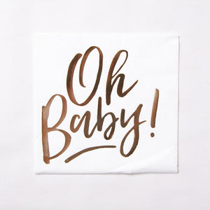 "A white baby shower napkin with the phrase ""Oh Baby!"" written in rose gold text"