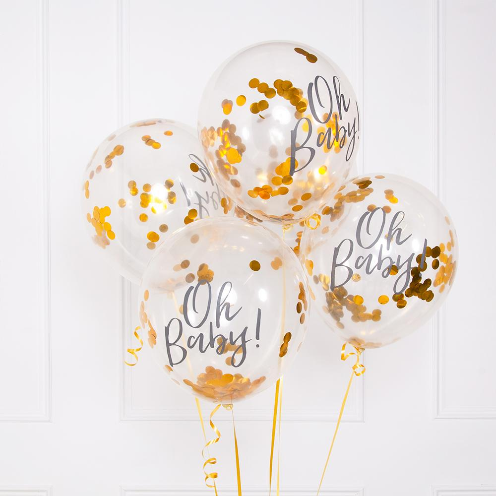 A bunch of clear baby shower balloons filled with gold foil confetti