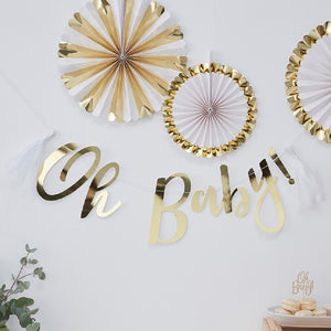 "A baby shower party banner saying ""Oh Baby!"" in gold foil cursive text"