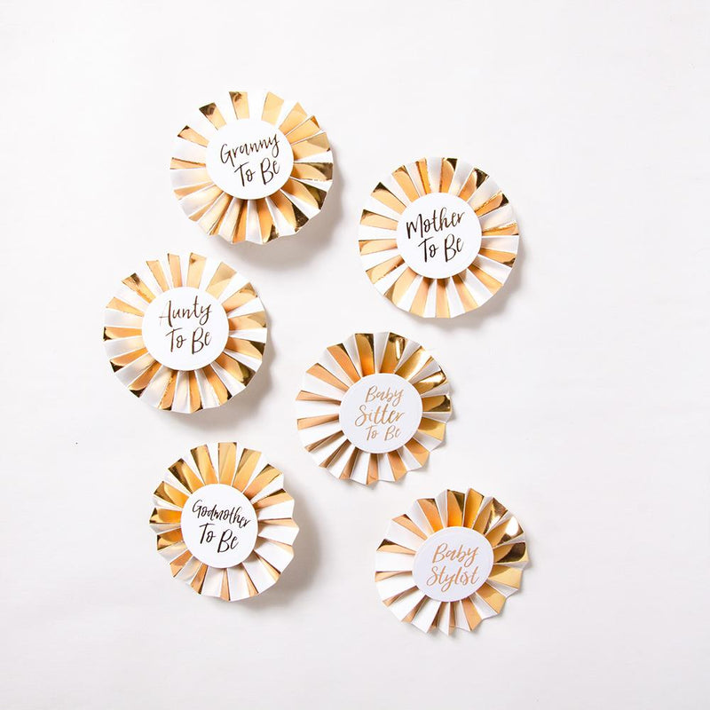 6 gold and white baby shower roundels with cursive text phrases