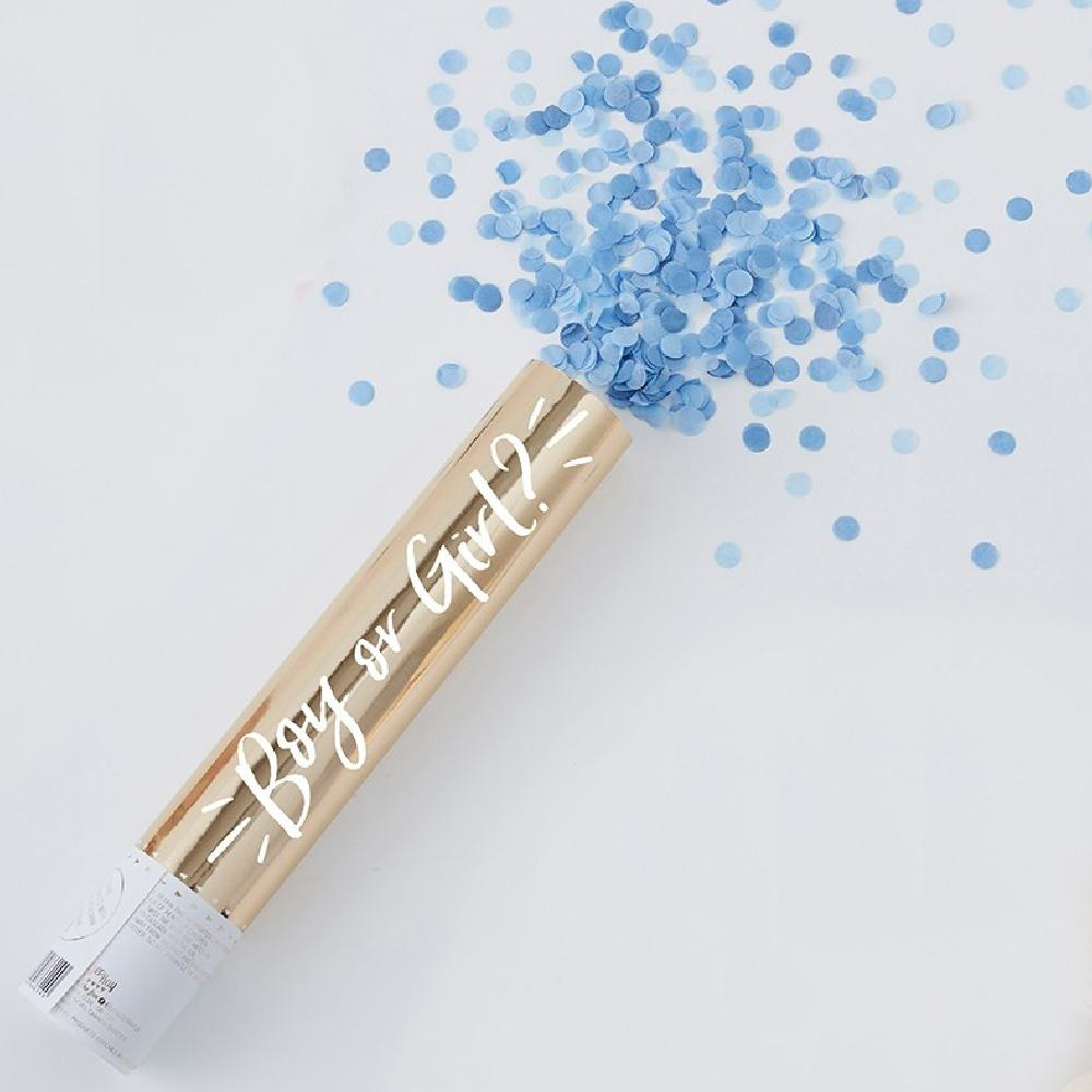 A gold gender reveal confetti cannon with a burst of blue confetti shooting out the top