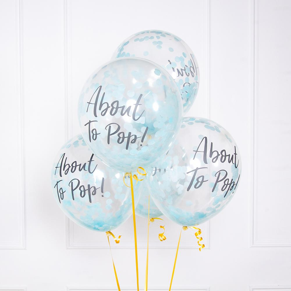 A bunch of 4 clear blue baby shower balloons tied with yellow balloon ribbon