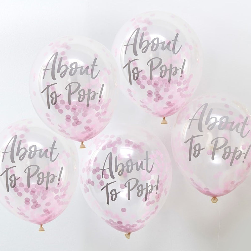 A bunch of clear latex party balloons filled with pink confetti