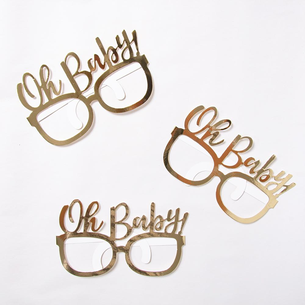 "3 pairs of gold foil baby shower party glasses with the phrase ""Oh Baby"" on top of the frames"