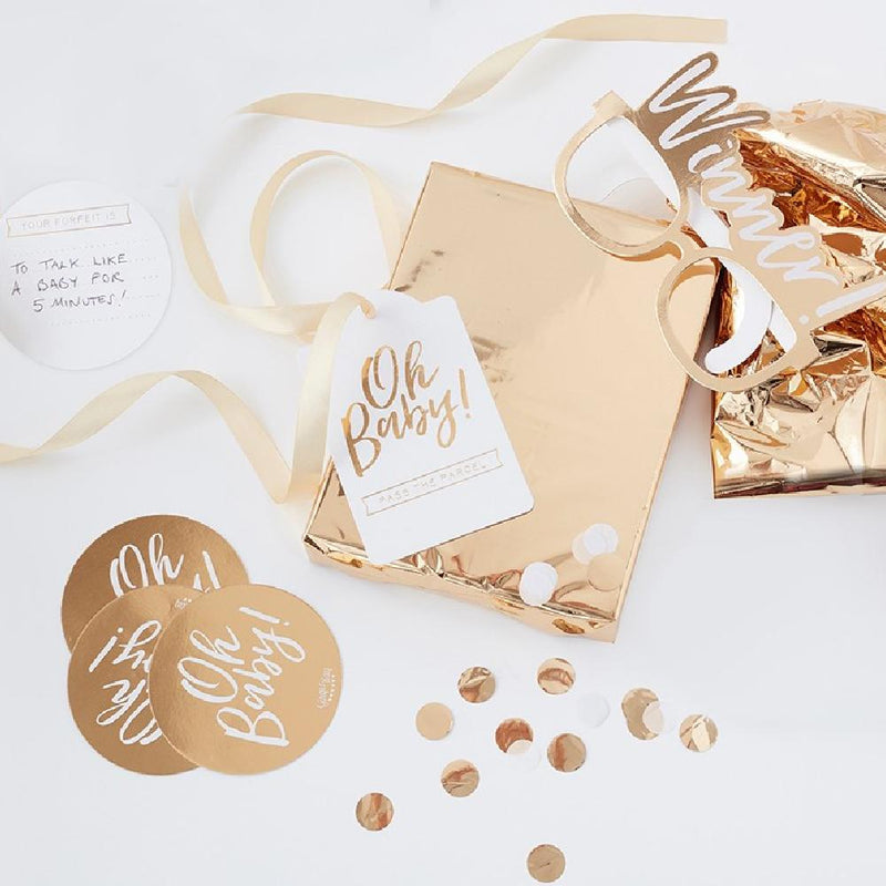 A shiny gold foil pass the parcel game kit for a baby shower