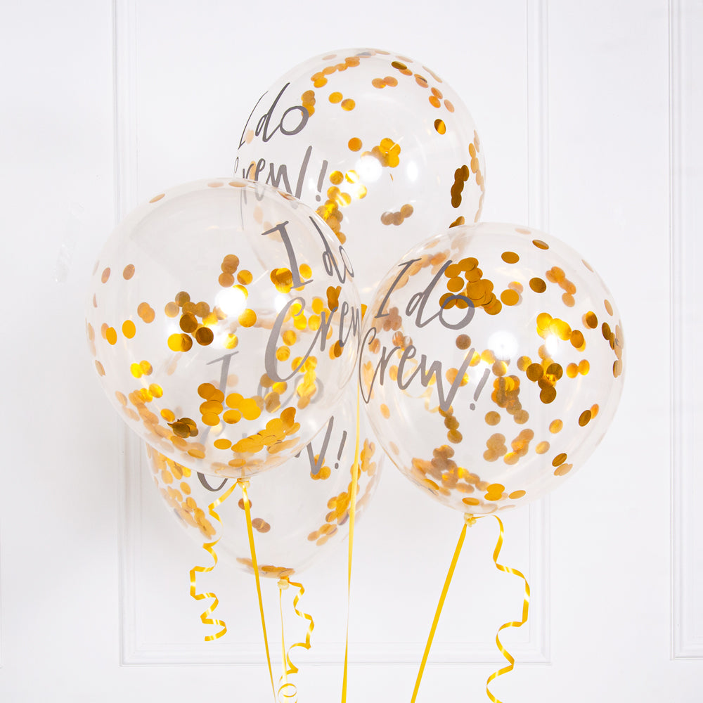 "3 clear hen party balloons filled with gold confetti and decorated with ""I Do Crew!"" phrase"